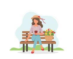 mujer en el banco con café y flores