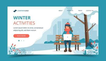 Girl sitting on bench in winter with laptop