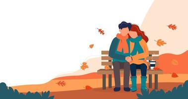 Loving couple on bench in autumn