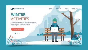 hombre en banco en invierno con página de inicio del portátil
