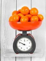 Tangerines on scales photo