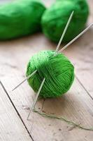 Clew of yarn with needles for knitting