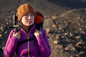 Chinese woman backpacker hiking photo