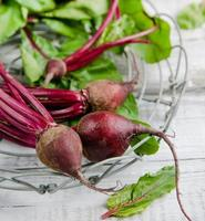 Young, fresh organic beets with green leaves