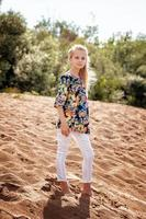 Young model posing in casual clothes on beach photo