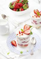 Strawberry tiramisu, trifle, custard dessert with mint leaves