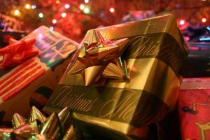 Christmas gifts under tree photo