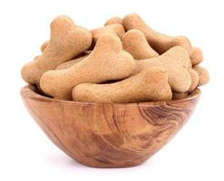 Snack food for dogs biscuits in wooden bowl