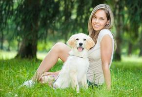 Woman playing with her golden retriever outdoors