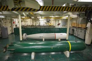 Torpedoes in the torpedo shop, USS Hornet photo