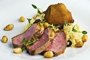 Duck breast steak with couscous photo