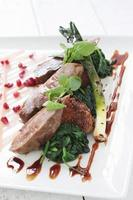 pan fried duck breast with polenta and spiniach