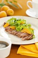 Peach, rucola and duck meat salad