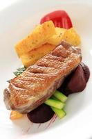 pan fried duck breast with pollenta chips