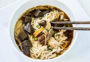 Thai noodle with duck on white plate