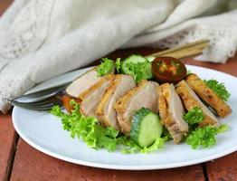 salad with grilled duck fillet, tomato and green lettuce