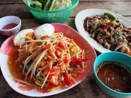 Spicy green papaya salad, spicy duck salad