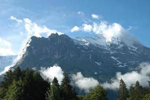 Ridge and Eiger peak in clouds nearby Grindelwald in Switzerland