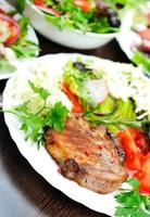 Salad and meat photo