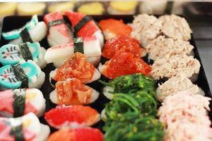 Japanese sushi - sushi egg, shrimp, crab stick, seaweed.