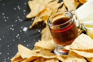 Dark beer mugs in an old-fashioned and nachos photo