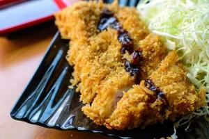 Tonkatsu deep fried pork cutlet serve with slice cabbage