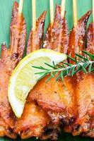 Fresh made chicken wing satay skewer