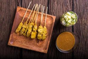 Pork Satay, Traditional Thai barbecue roasted pork photo