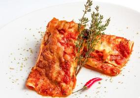 Mexican chicken enchiladas with spicy tomato sauce and cheese. photo