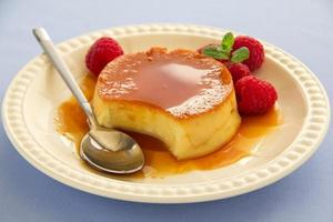 Creme caramel with raspberries.