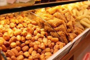 Nuts and baklava on market shelf