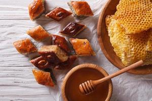 Delicious baklava and honey close-up horizontal top view