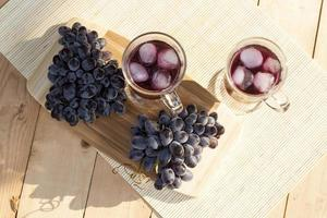 Grape juice and fresh blue grapes