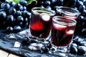 Cold dark grape juice with ice