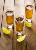 Tequila in shot glasses with lime and salt