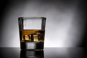 glass of whiskey with ice photo