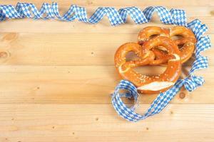 Salty pretzels on wooden board
