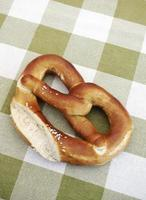 German Brezel on green and white tablecloth
