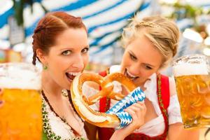 Women with traditional Bavarian clothes in beer tent