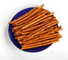 Salty bread finger snacks on a blue plate
