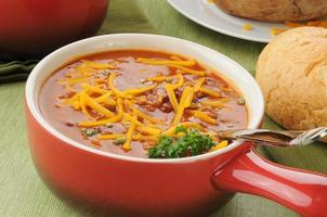 Chili with cheese in a serving crock photo