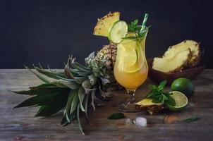 Cold refreshing pine apple cocktail drink with lime and mint