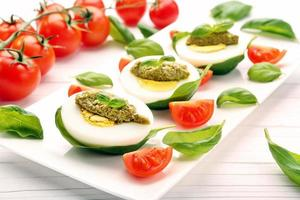 Easter eggs with pesto and cherry tomatoes