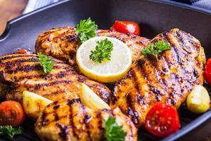 Grilled chicken breast in different variations photo
