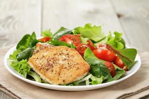 Roasted chicken with vegetable salad and herbs