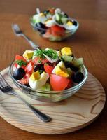 Fresh spring mixed vegetable salad with eggs photo