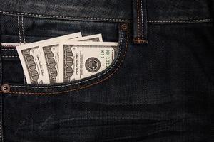 Dollars in jeans pocket photo