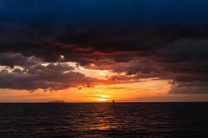sunset over the sea photo