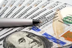 Business concept - money and pen photo