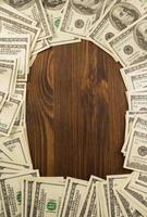 dollars money banknotes on wood photo